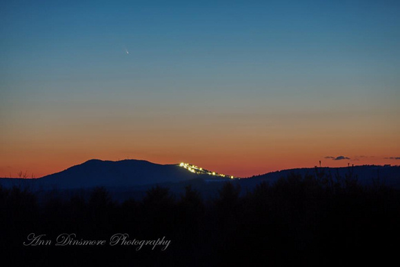Photo of Comet PANSTARRS (upper left, over the mountain), courtesy of Ann Dinsmore Photography. Thank you, Ann! Taken after sunset on March 13, 2013, in New Boston, NH. Click here for a larger view