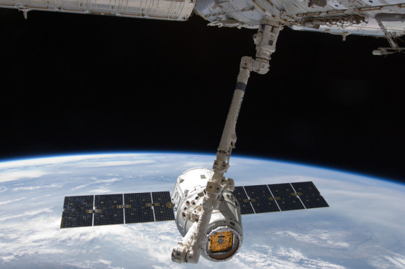 The first SpaceX Dragon capsule pauses near the International Space Station on May 31, 2012 so the ISS' robotic arm can grapple and berth it to a port on the station. Today's Dragon departure from ISS was similar. Photo via NASA
