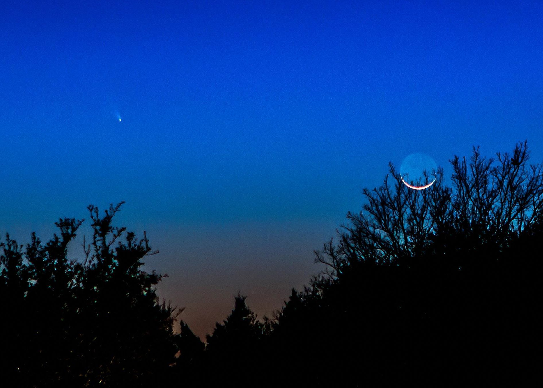EarthSky Facebook friend Milton Otto of Austin, Texas captured this image of Comet PANSTARRS near the young  moon on March 12, 2013.  Awesome shot, Milton!  Thank you.  View larger.
