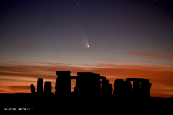 Comet PANSTARRS above the Stonehenge monument in March, 2013.  Image via Simon Banton