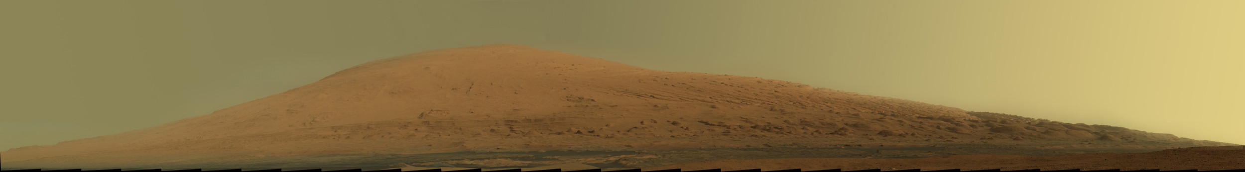 Raw color image of Mount Sharp. This is what it would look like to your human eyes if you were standing on Mars. Image via NASA.