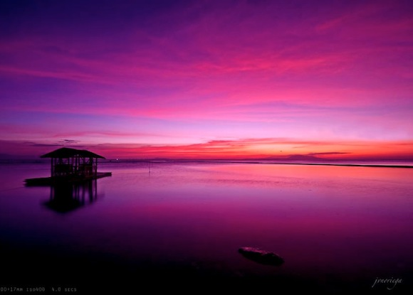 Purple sky with pink clouds over the West Philippine Sea.