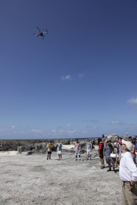 UAV launching around field trip participants during a test flight above the outcrop of interest. Photo by Chris Zahm.