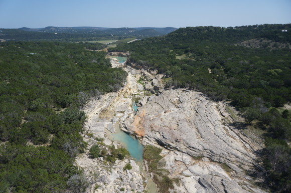 Oblique view into Canyon Lake Gorge near San Antonio, Texas. This view highlights the outcrop exposure of the Hidden Valley Fault and demonstrates the benefit of an elevated perspective. Photo by Robert Youens, CameraWings for BEG-RCRL research group.
