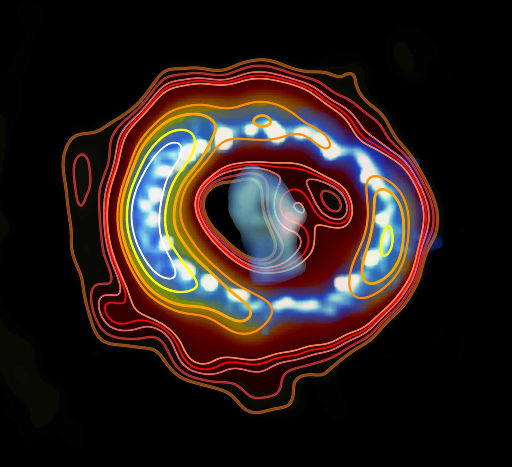 An overlay of radio emission (contours) and a Hubble space telescope image of Supernova 1987A.  Image via ICRAR (radio contours) and Hubble (image.)   View larger.