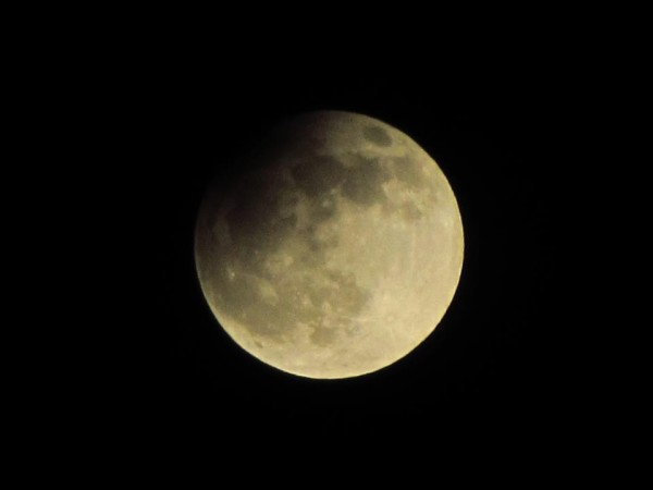 A view of the April 25 lunar eclipse from Prague from our friend Raymond Johnston.  Thanks, Raymond.