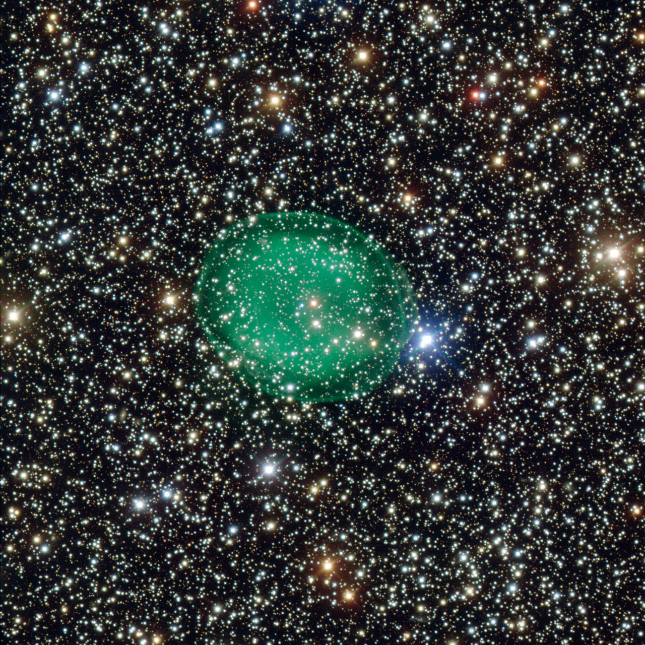 The glowing green planetary nebula IC 1295 surrounding a dim and dying star some 3,300 light-years away. View larger. Image via ESO's Very Large Telescope.