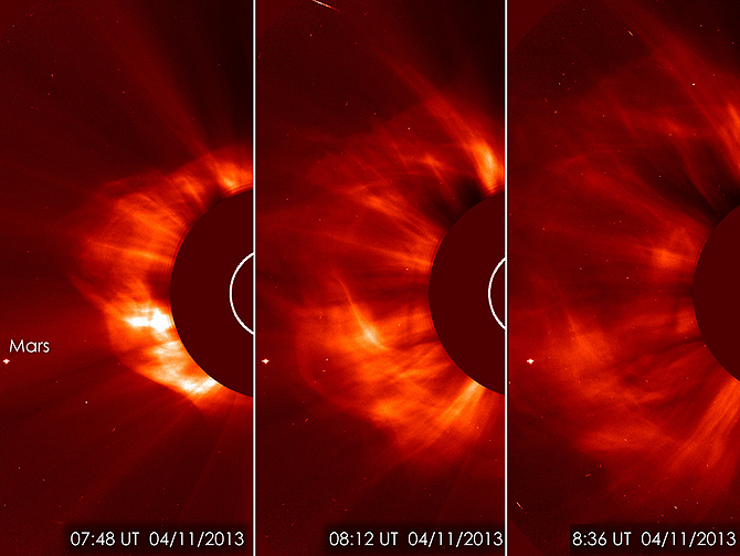The Solar Heliospheric Observatory (SOHO) captured this series of images of a coronal mass ejection (CME) on the morning of April 11, 2013. The planet Mars can be seen on the left.  View larger. Image via ESA/NASA/SOHO/GSFC