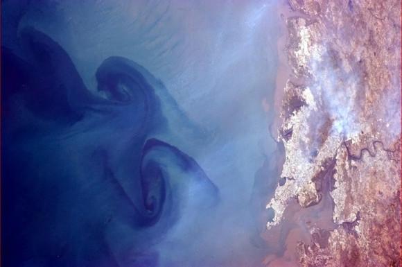 'Huge swirls in the sea off Mumbai, India.' Photo credit: Chris Hadfield/NASA