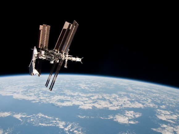 First-ever image of a space shuttle docked at the International Space Station. This is the shuttle Endeavour, and the year is 2011.
