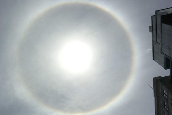 Solar halo over Union Square in New York City on May 14, 2013. Photograph by John Zenkus. Thank you, John! See below for the reaction of the crowd.