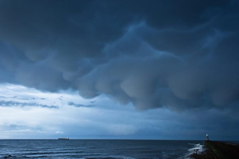 Low bulging clouds over the sea.