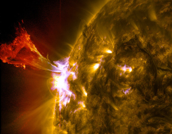 A burst of solar material leaps off the left side of the sun in what's known as a prominence eruption. This image combines three images from NASA's Solar Dynamics Observatory captured on May 3, 2013, at 1:45 pm EDT, just as an M-class solar flare from the same region was subsiding. The images include light from the 131-, 171- and 304-angstrom wavelengths. Credit: NASA/SDO/AIA