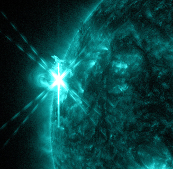 NASA's Solar Dynamics Observatory captured this image of an M5.7-class flare on May 3, 2013, at 1:30 p.m. EDT. This image shows light in the 131-angstrom wavelength, a wavelength of light that can show material at the very hot temperatures of a solar flare and that is typically colorized in teal. Credit: NASA/SDO/AIA