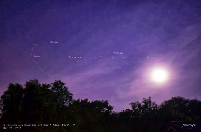 View larger. | Jv Noriega in Manila, Philippines also caught the supermoon as it was setting on the morning of May 25, 2013.  The constellation Scorpius was near the moon.  Scorpius' bright star Antares could be seen in the moon's glare.
