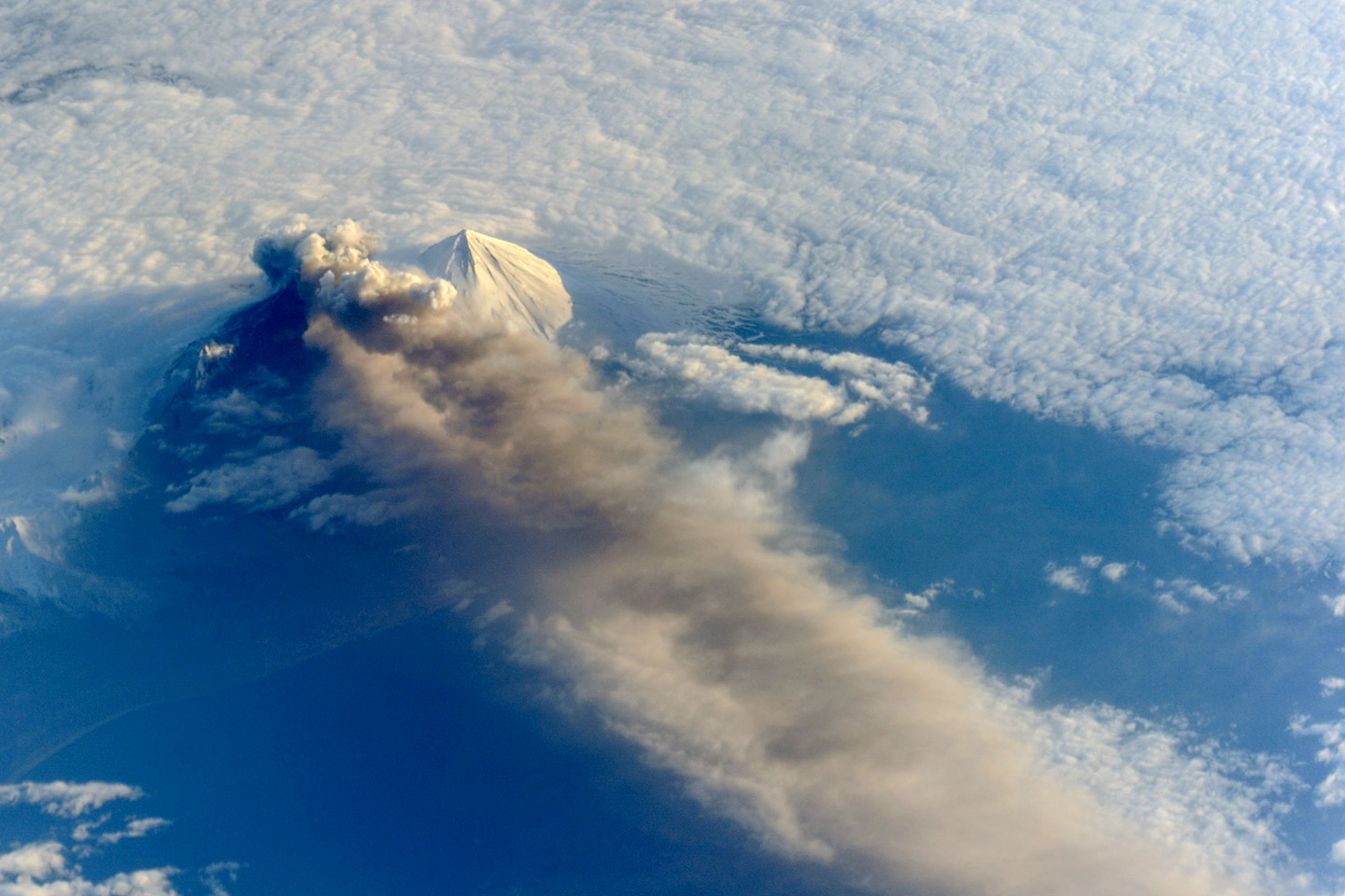 View larger. | Pavlof Volcano in the Aleutian Arc on May 18, 2013. The volcano began erupting May 13, jetted lava into the air and spewed an ash cloud 20,000 feet (6,000 meters) high. Image via NASA.