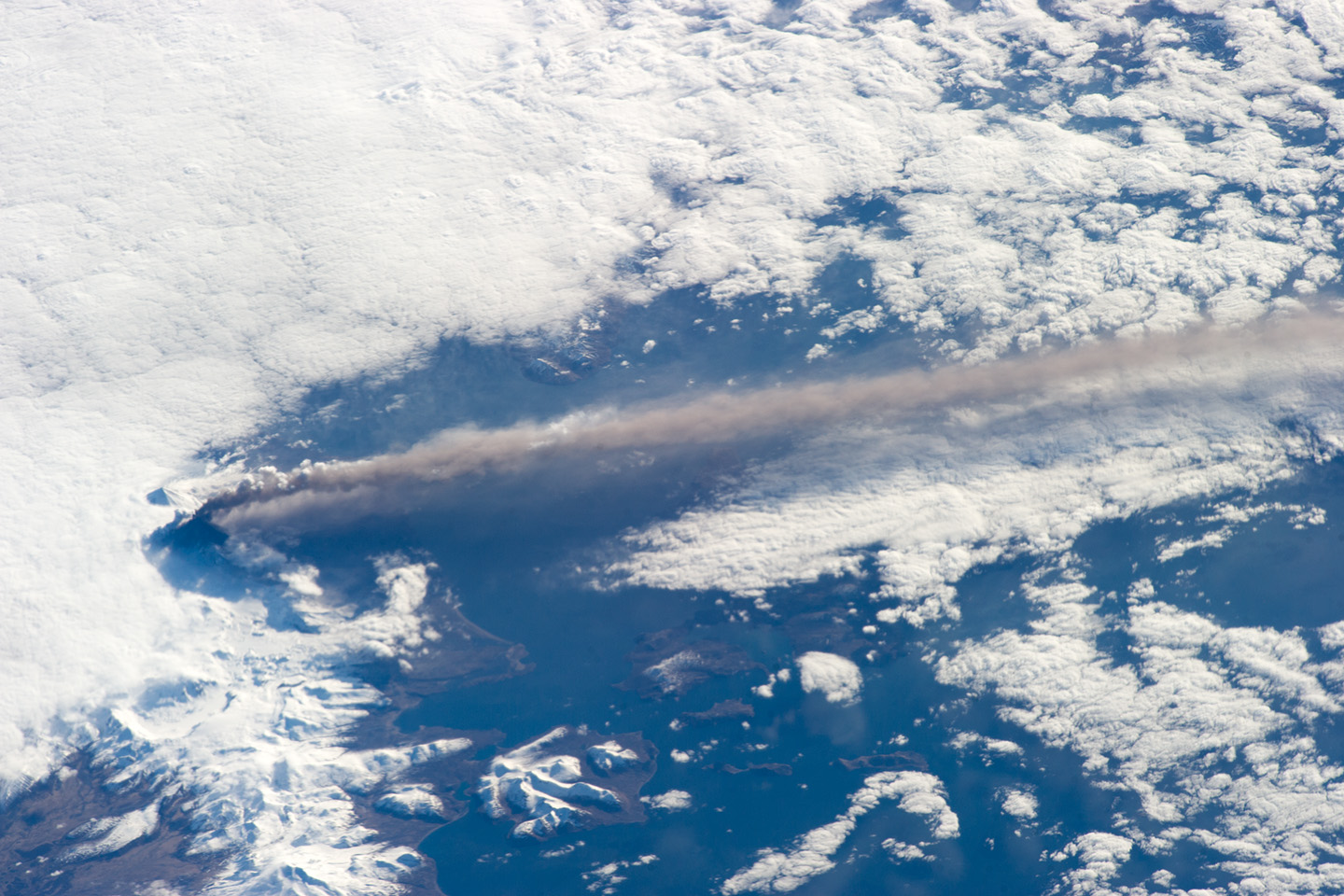 View larger. | The volcanic plume extended southeastward over the North Pacific Ocean. Image via NASA.