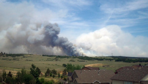 Black forest wildfire burning in the distance. Image Credit: State Farm (via Flickr)
