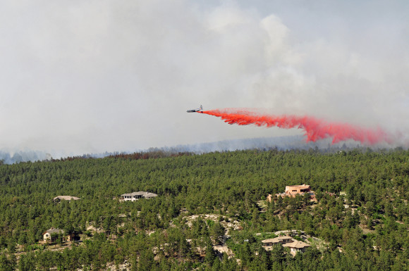 An aircraft releases a fire-retardant solution to help stop the spreading of fires at Black Forest, Colorado, June 12, 2013. Image Credit: U.S. Army photo by Sgt. Jonathan C. Thibault/Fort Carson Public Affairs Office