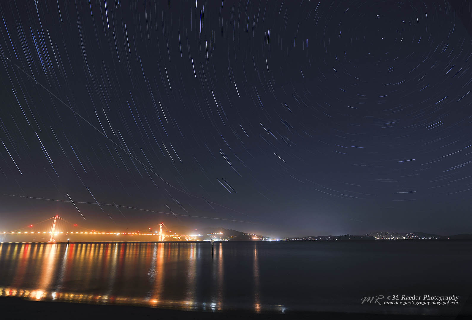 View larger. | Golden Gate, San Francisco, with star trails around Polaris, from Meggi Raeder Photography. Visit Meggi's website here.