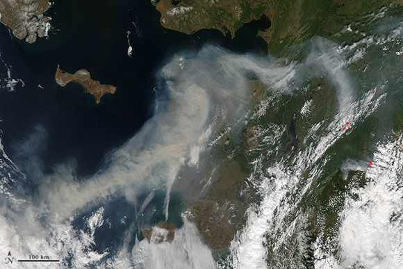 Satellite image of smoke from wildfires burning in western Alaska on June 19, 2013. Read more about this image here. NASA image by Jeff Schmaltz, LANCE/EOSDIS Rapid Response.