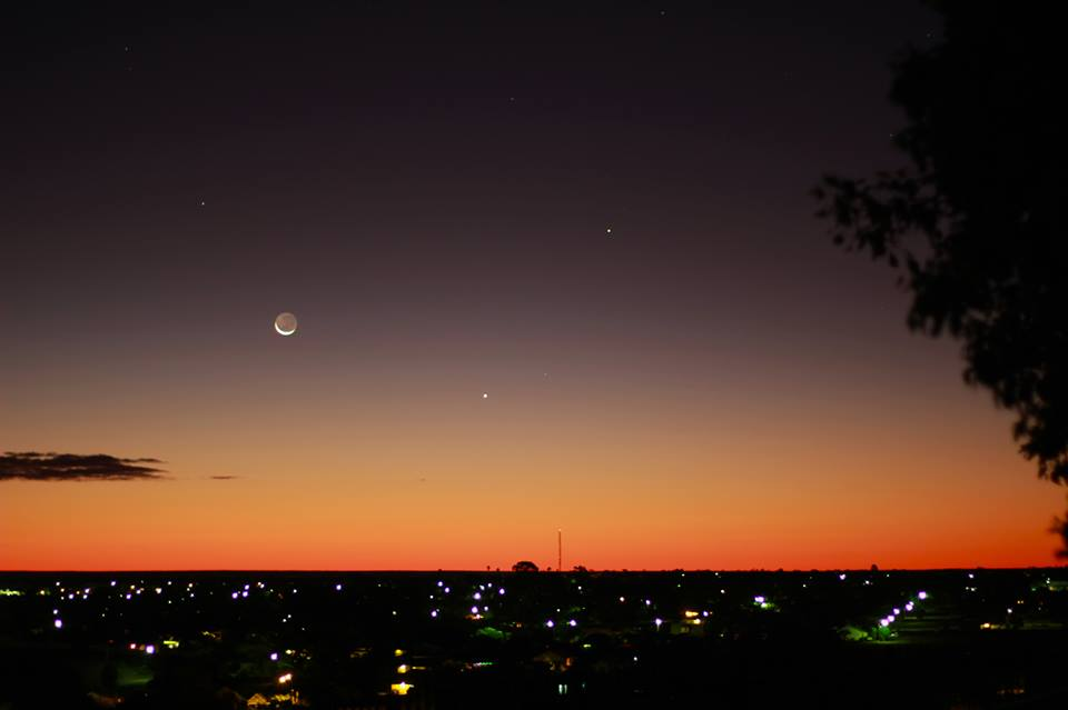 View larger. | Can't find Venus in daylight?  Try it at night!  Venus is the brightest planet and will be easily visible in the west after sunset through the end of 2013.   Here are the slim waning crescent moon, plus Venus (brightest, closest to horizon) and Mercury (higher up, a bit fainter than Venus) on June 10, 2013 as seen from Kalgoorlie in western Australia.  Photo by EarthSky Facebook friend Oliver Floyd.  Thanks, Oliver!