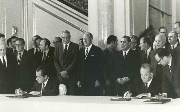 President Richard Nixon (seated at left) and Premier Alexei Kosygin sign the Agreement between the Government of the United States of America and the Government of the Union of Soviet Socialist Republics on Cooperation in the Fields of Science and Technology; which included the agreement governing the Apollo–Soyuz Test Project. The agreement was signed during the bilateral summit in Moscow, May 24, 1972.  Image via NASA.