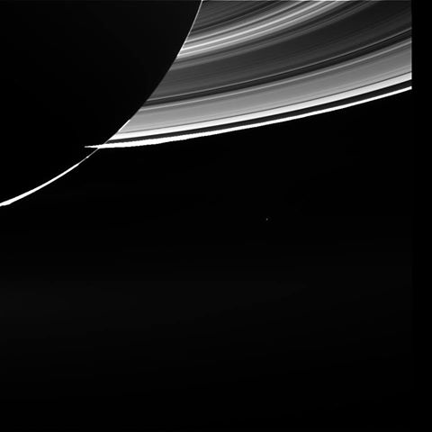 Earth seen near Saturn's rings and Saturn nightside on July 1, 2013. Earth is the dot below the backlit rings. Image via NASA / JPL / ESA. Cassini spacecraft.