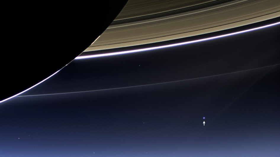In this rare image taken on July 19, 2013, the wide-angle camera on NASA's Cassini spacecraft has captured Saturn's rings and our planet Earth and its moon in the same frame. It is only one footprint in a mosaic of 33 footprints covering the entire Saturn ring system (including Saturn itself).  At each footprint, images were taken in different spectral filters for a total of 323 images: some were taken for scientific purposes and some to produce a natural color mosaic.  This is the only wide-angle footprint that has the Earth-moon system in it.