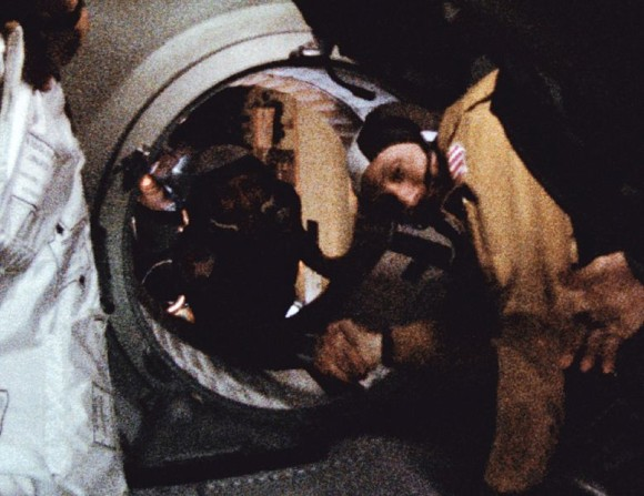 Astronaut Thomas P. Stafford (in foreground) and cosmonaut Aleksei A. Leonov make their historic handshake in space on July 17, 1975 during the joint U.S.-USSR Apollo Soyuz Test Project (ASTP) docking mission in Earth orbit. This picture was reproduced from a frame of 16mm motion picture film.  Image via NASA.