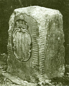 A boundary marker on the Mason–Dixon line. These markers were originally placed at every 5th mile along the line. The coat of arms of Maryland's founding Calvert family is shown. On the other side are the arms of William Penn, whose son Thomas was founder of the Province of Pennsylvania.