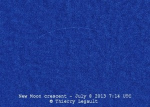 Blue background with extremely thin hairlike partial crescent.