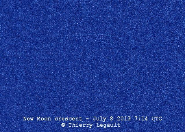 Thread-like crescent on blotchy blue background.
