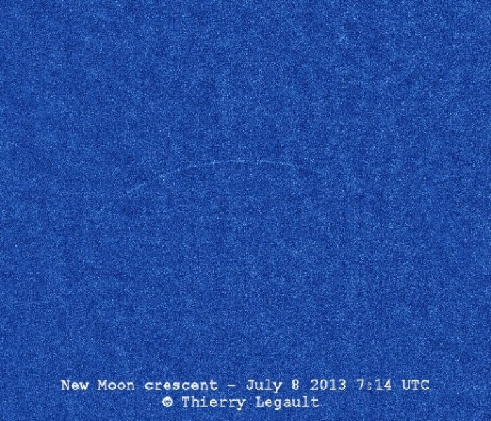 View larger. | Youngest possible lunar crescent, with the moon's age being exactly zero when this photo was taken — at the precise moment of the new moon - at 07:14 UTC on July 8, 2013.  Image by Thierry Legault.  Visit his website.  Used with permission.