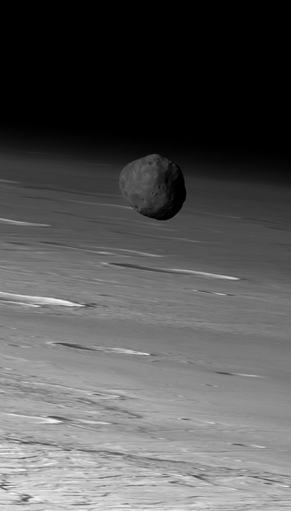 The larger of Mars' two moons, Phobos, orbiting in front of Mars. Image via Mars Express / ESA / DLR / FU Berlin (G. Neukum).