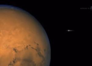 Artist's concept Comet ISON flies by Mars.  Via NASA