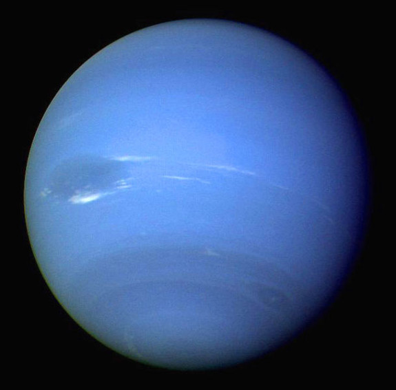 Voyager 2 passed Neptune in 1989.  It saw cloud features in Neptune's atmosphere, tracked by the Voyager cameras as the craft swept past.  Image via NASA.