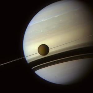 Saturn and Titan as seen by Cassini.