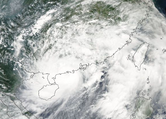 Typhoon Utor weakening over Southeast China on August 14, 2013. Image Credit: NASA