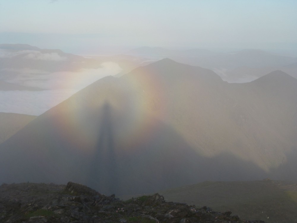 View larger. | The Brocken Spectre, as captured by Micheal Burke on June 22, 2013.  Micheal was atop Carrauntoohil, highest peak in Ireland. Located in County Kerry