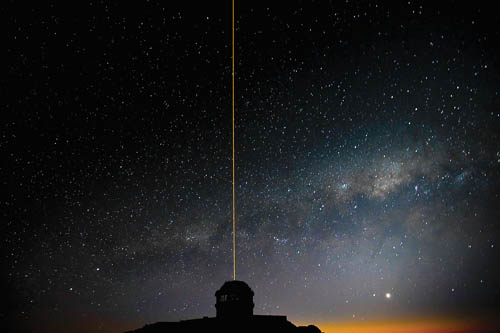 The Gemini South GeMS laser propagates into the night sky as the Milky Way rises during GeMS/GSAOI System Verification observations. Image via Gemini Observatory/AURA