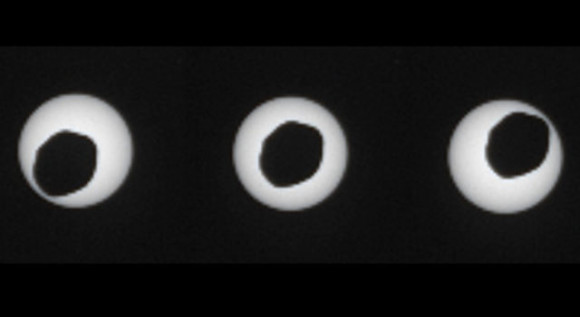 The larger of Mars' two moons, Phobos, is passing in front of the sun in this set of three images, taken three seconds apart. Images from August 17, 2013 via NASA's Mars rover Curiosity.