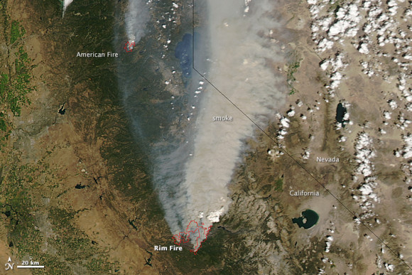NASA's Aqua satellite acquired this image of the Rim Fire on August 22, 2013. Red outlines indicate hot spots where the satellite's instruments detected unusually warm surface temperatures associated with fires. Winds blew a thick smoke plume toward the northeast. A smaller fire—American fire—burned to the north. NASA image by Jeff Schmaltz, LANCE/EOSDIS Rapid Response.