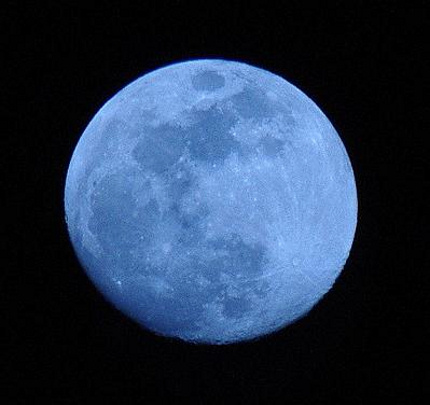 Nearly full moon, light blue in color.