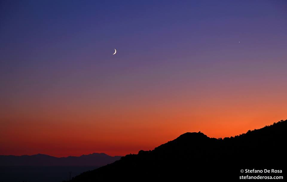 View larger. | Moon and Venus as seen August 10, 2013 by Stefano De Rosa at Isola D'Elba, Italy.  See more of Stefano's photos here.