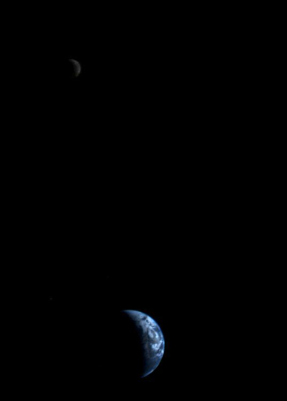As Voyager 2 sped away from Earth, it looked back and acquired this image of a crescent-shaped Earth and moon -- the first of its kind ever taken by a spacecraft -- on Sept. 18, 1977. Voyager 2 was 7.25 million miles (11.66 million kilometers) from Earth at the time. Image via NASA.
