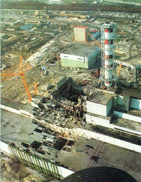 Chernobyl Nuclear Power Plant, after the explosion. Extensive damage to the main reactor hall is seen in the center of the image, and in the turbine building, in the lower left. Image credit: U.S.S.R. Government photo, via Wikimedia Commons.