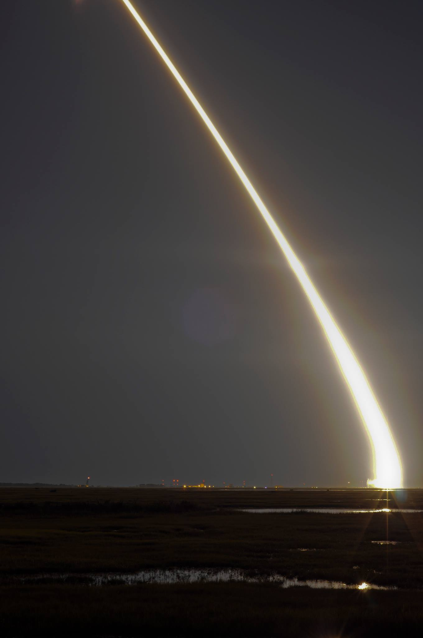 View larger. | LADEE launch on September 7, 2013 as captured by our friend Aaron Oberlander.  He said he took this photo from a bridge near Wallops Island, Virginia.  Thank you, Aaron!