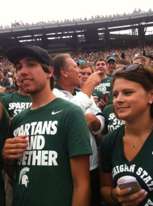Tom Izzo kept his promise and joined the student section after a storm delay Saturday, September 7, 2013. Image Credit: Twitter via @fiveburger