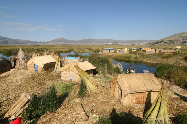 Village on a floating Uros reed island in Peru. Image credit: Emre Safak via Wikimedia Commons.